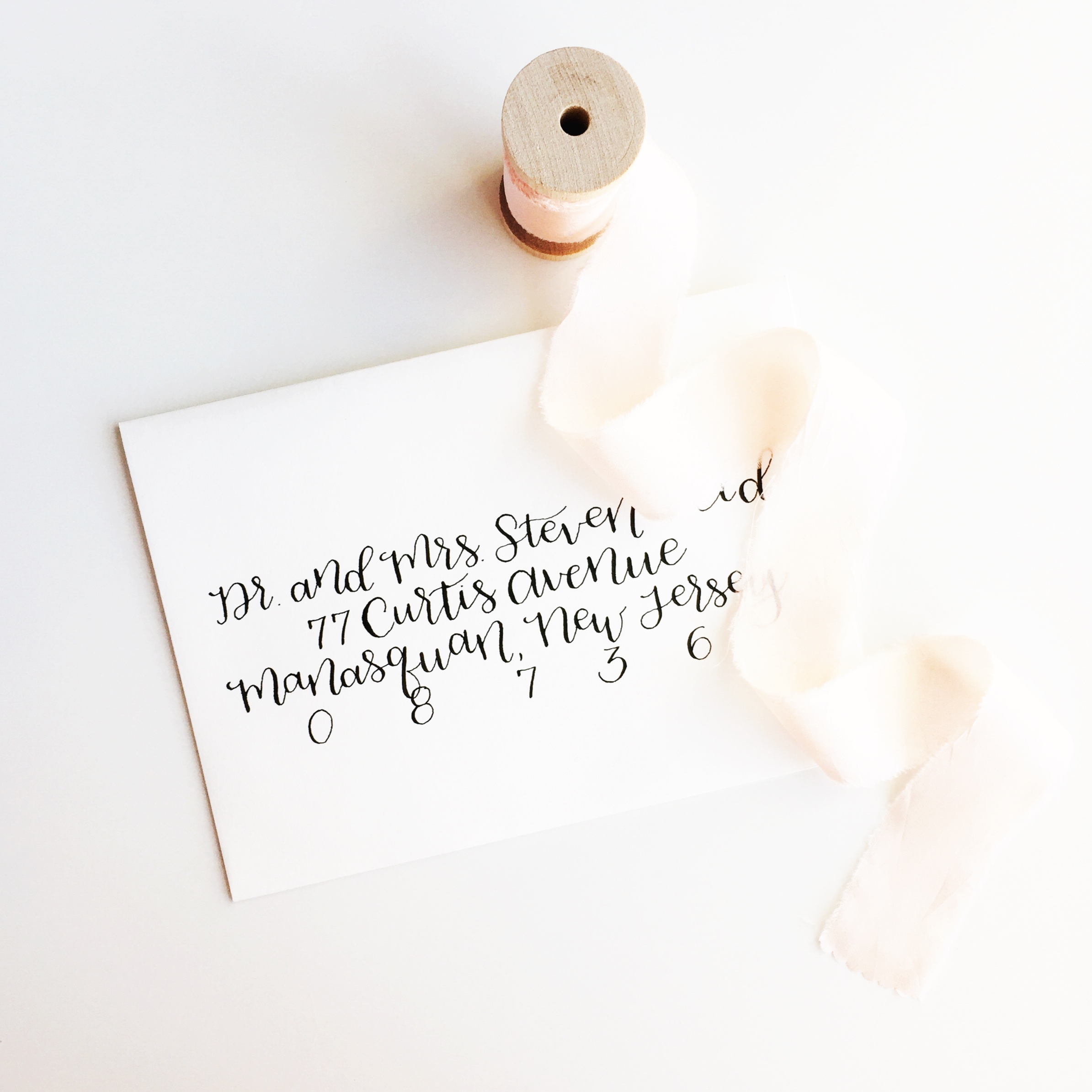 calligraphy-envelope-pink-ribbon