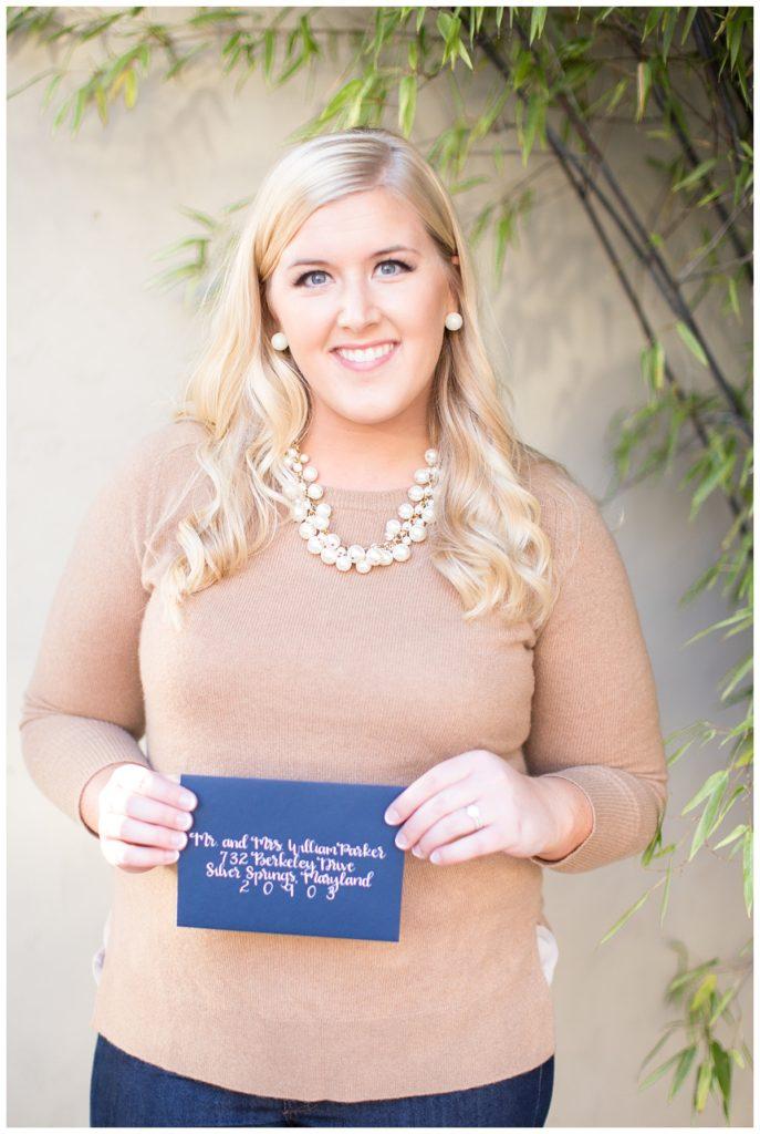 blonde-headshot-tan-cashmere-sweater-calligraphy-navy-envelope